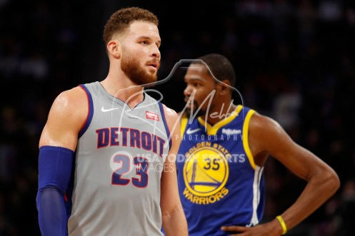 Dec 1, 2018; Detroit, MI, USA; Detroit Pistons forward Blake Griffin (23) walks in front of Golden State Warriors forward Kevin Durant (35) during the fourth quarter at Little Caesars Arena. Mandatory Credit: Raj Mehta-USA TODAY Sports