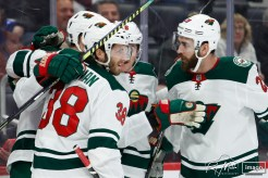 Feb 27, 2020; Detroit, Michigan, USA; Minnesota Wild right wing Ryan Hartman (38) celebrates with teammates after scoring a goal during the first period against the Detroit Red Wings at Little Caesars Arena. Mandatory Credit: Raj Mehta-USA TODAY Sports