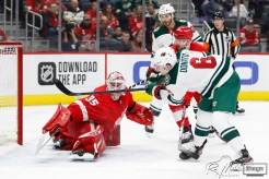 Feb 27, 2020; Detroit, Michigan, USA; Minnesota Wild center Ryan Donato (6) scores a goal against Detroit Red Wings goaltender Jimmy Howard (35) during the first period at Little Caesars Arena. Mandatory Credit: Raj Mehta-USA TODAY Sports