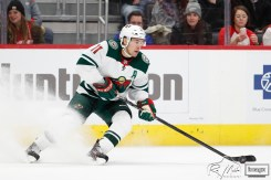 Feb 27, 2020; Detroit, Michigan, USA; Minnesota Wild left wing Zach Parise (11) controls the puck during the first period against the Detroit Red Wings at Little Caesars Arena. Mandatory Credit: Raj Mehta-USA TODAY Sports