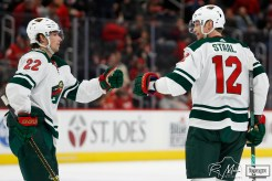 Feb 27, 2020; Detroit, Michigan, USA; Minnesota Wild center Eric Staal (12) celebrates with left wing Kevin Fiala (22) after scoring a goal during the third period against the Detroit Red Wings at Little Caesars Arena. Mandatory Credit: Raj Mehta-USA TODAY Sports