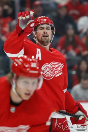 Mar 2, 2020; Detroit, Michigan, USA; Detroit Red Wings center Dylan Larkin (71) puts up his hand before play starts during the first period against the Colorado Avalanche at Little Caesars Arena. Mandatory Credit: Raj Mehta-USA TODAY Sports