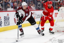 Mar 2, 2020; Detroit, Michigan, USA; Colorado Avalanche center Vladislav Kamenev (81) skates with the puck against Detroit Red Wings center Frans Nielsen (81) during the third period at Little Caesars Arena. Mandatory Credit: Raj Mehta-USA TODAY Sports