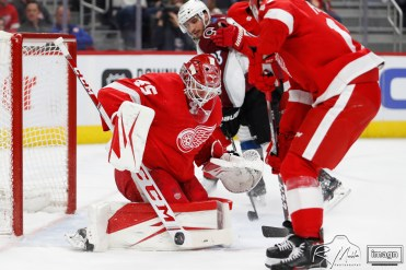 Mar 2, 2020; Detroit, Michigan, USA; Detroit Red Wings goaltender Jonathan Bernier (45) makes a save against Colorado Avalanche left wing Matt Nieto (83) during the third period at Little Caesars Arena. Mandatory Credit: Raj Mehta-USA TODAY Sports