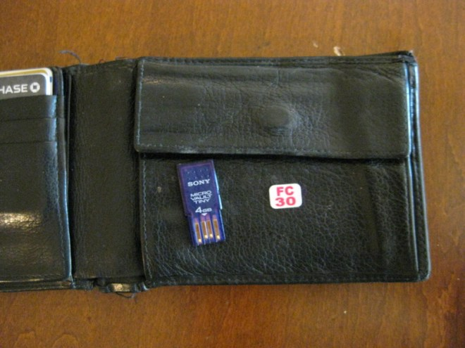 Just stick the thin USB flash drive in the change pocket of your wallet