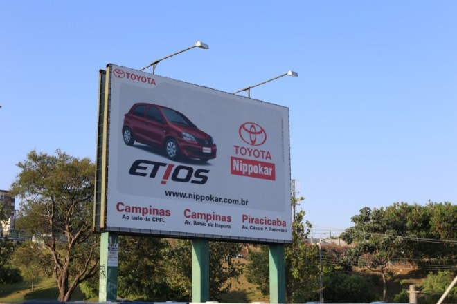 Billboard in Campinas (the majority of cars in Brazil are small)