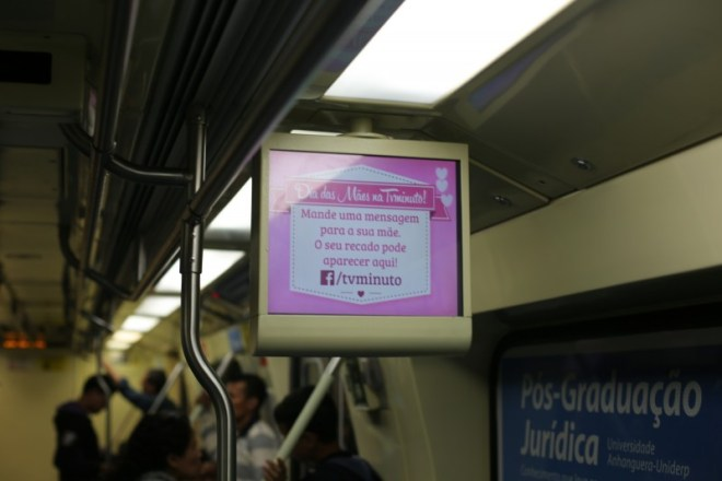 Facebook (not Twitter) in an ad on the subway.