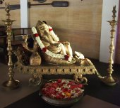 Ganesha gives his blessing in a relaxed fashion