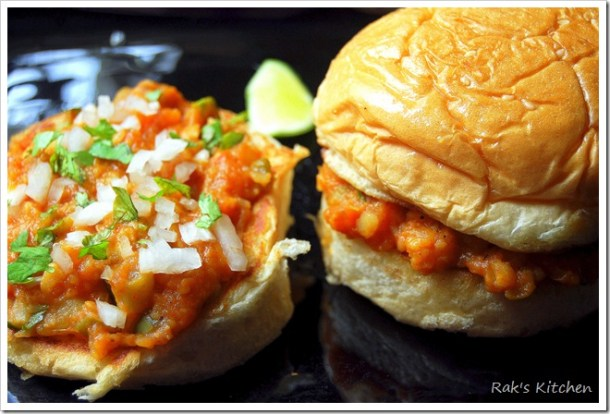 Buns spread with bhaji and topped with chopped onion and coriander leaves