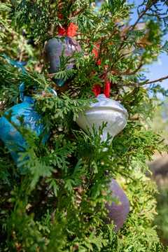 Raku Christmas ornaments handmade on a wheel.