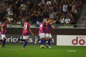 Podolski celebrates a goal with Vissel Kobe teammates in his debut J.League match for the team