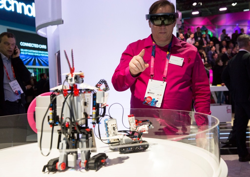 A visitor to Mobile World Congress operates a robot using augmented reality technology.