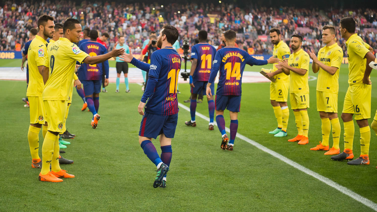 """Lionel Messi walks onto the pitch against Villareal: On the front of the shirts, under the Rakuten Logo, were the words """"TRUE CHAMPIONS,"""" recognizing the incredible importance that mothers play..."""