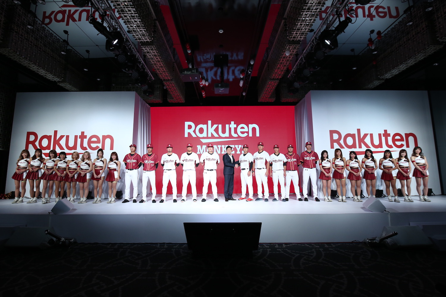 Rakuten CEO Mickey Mikitani (center), took to the stage in December 2019 to unveil the new name, logo and jersey design of CPBL juggernauts, the Rakuten Monkeys.