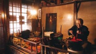 A Hida artisan crafts warasoku, a Japanese sumac candle via livestream.