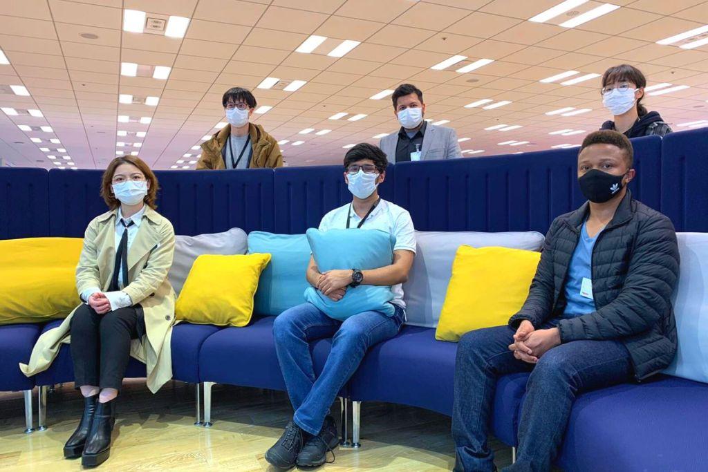 Anshul Bhatt, Business Unit Head, AI Platforms, Rakuten Mobile, (back row, middle) with team members at Rakuten Crimson House in Tokyo.