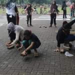 Kegiatan permainan rakyat di lapangan Merdeka Binjai. Foto: Istimewa