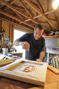 Georges Le Chevallier creating in the studio.