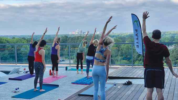 Fytte customers engaging in a sunrise yoga session