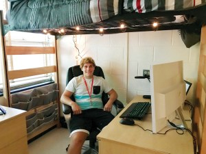 Freshman Cole Stewart in his dorm room in Sullivan Residence Hall