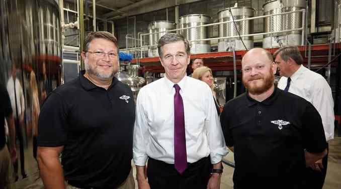 Brandon Evans, Governor Roy Cooper and Scott Russ