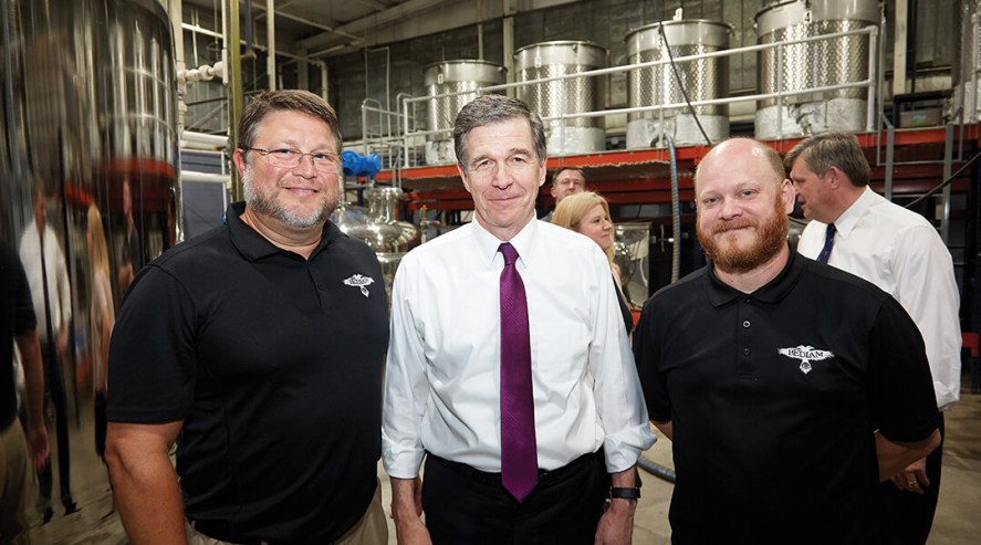 Brandon Evans, Governor Roy Cooper and Scott Russ