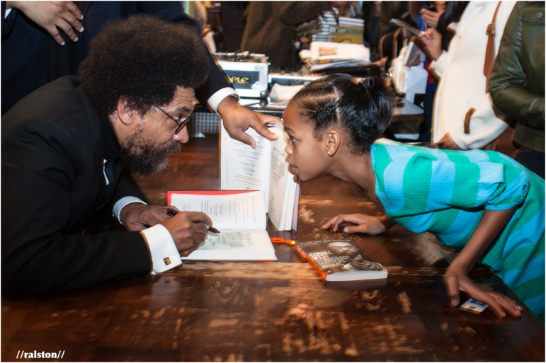 dr. cornel west meets a fan at his book signing
