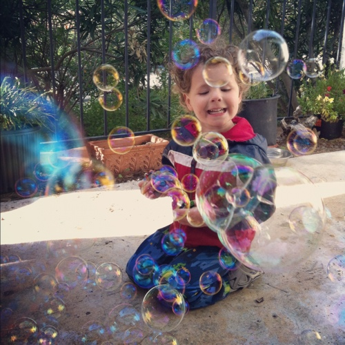 Toddler with bubbles
