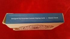 Left: Designed by Encarded Custom Playing Cards Master Finish