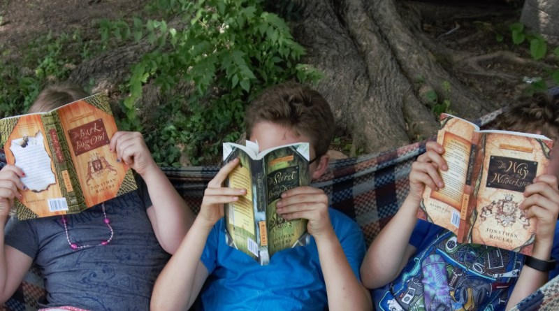 Children reading The Wilderking Trilogy