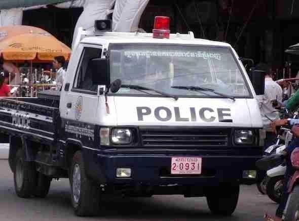 Police pick up truck in Cambodia