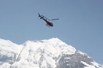 A helicopter flew and landed at the camp. I'm not sure what it was doing there. There was also an expeditition preparing to try to summit from the south side of the mountain - an incredibly dangerous task. Most people who want to summit Annapurna do it from the other side.