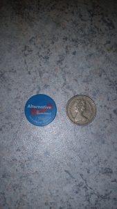 Doober next to a pound coin