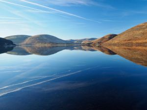 Reflections on the water at St Mary's Loch