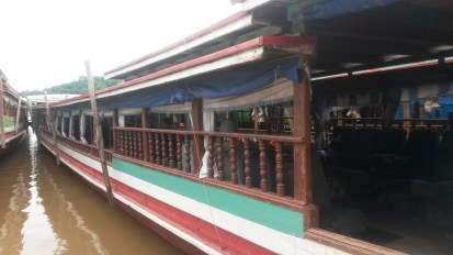 The boat crossing the border from Thailand into Laos along the Mekong