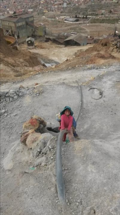 Kids of the miners playing and climbing up Cerro Rico