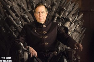 Belichick posing on the Iron Throne following his visit to Kings Landing following the Pats Superbowl win.