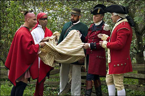 An unwashed Native American and his pirate friend accept a diseased blanket from three gay gentlemen.