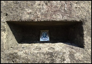 A religious icon placed on one of the many memorials at the former concentration camp.