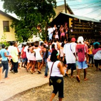 Belizeans' idea of an independece day parade float: people dancing in the back of a farm truck.