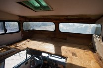 Cabover bed area with all the nasty carpet and moldy paneling removed. Will be fully braced, resurfaced, insulated and new bed installed.