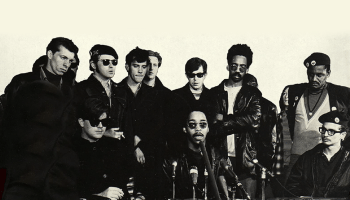 The Black Panthers and Young Patriots at a press conference in the 1960s.