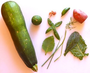 Soup ingredients (lime, basil leaves, tarragon, garlic cloves, a sweet potato and a BIG ZUCCHINI