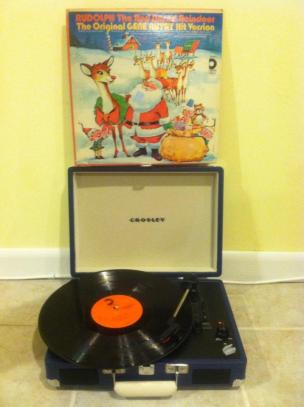 """November 20. This sweet record player-inside-of-a-suitcase that my friends Susan and Kara gave me for my birthday last year. Shown here also is the greatest Christmas album of all time: the original """"Rudolph the Red-Nosed Reindeer"""" tv special soundtrack, found at Sal's Army for two bucks!"""