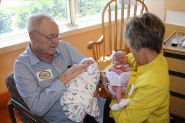 Both babies with Grandpa and Grammy.