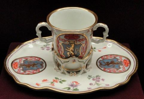 Chocolate_cup_and_trembleuse_stand_with_a_Cardinal's_coat-of-arms,_c._1735,_Du_Paquier_factory,_hard-paste_porcelain,_overglaze_enamels,_gilding_-_Gardiner_Museum,_Toronto_-_DSC01023