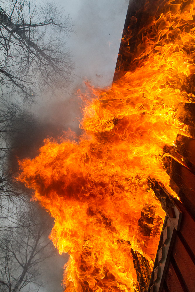 flames on a burning house