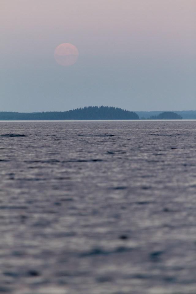 super moon of 2013 rising above a lake