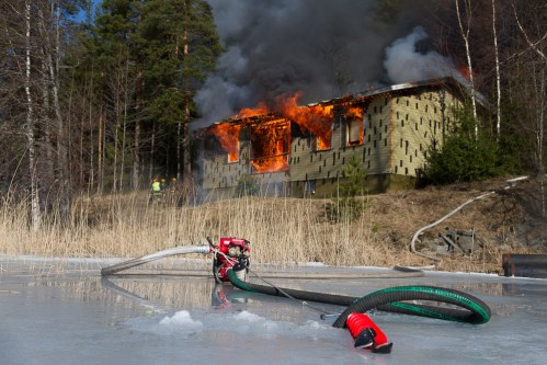 pump on ice in front of burning building