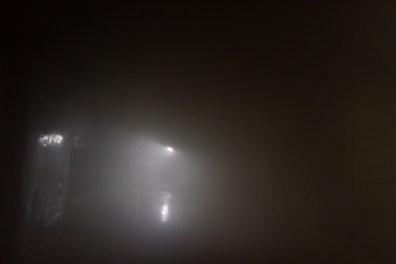 firesighter's light beam in a smoky room